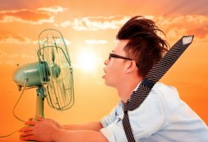hot man sitting in front of fan